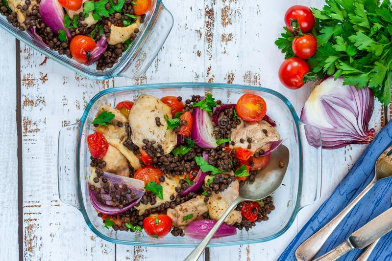 Chicken, puy lentils and cherry tomatoes bake. Chicken and cherry tomatoes bake with puy lentils - top view royalty free stock photo