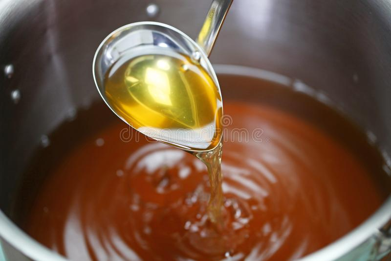 Chicken consomme soup in a pot stock photography