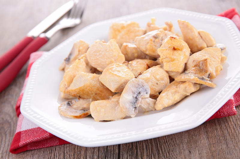 Chicken cooked with cream. And mushrooms stock photography