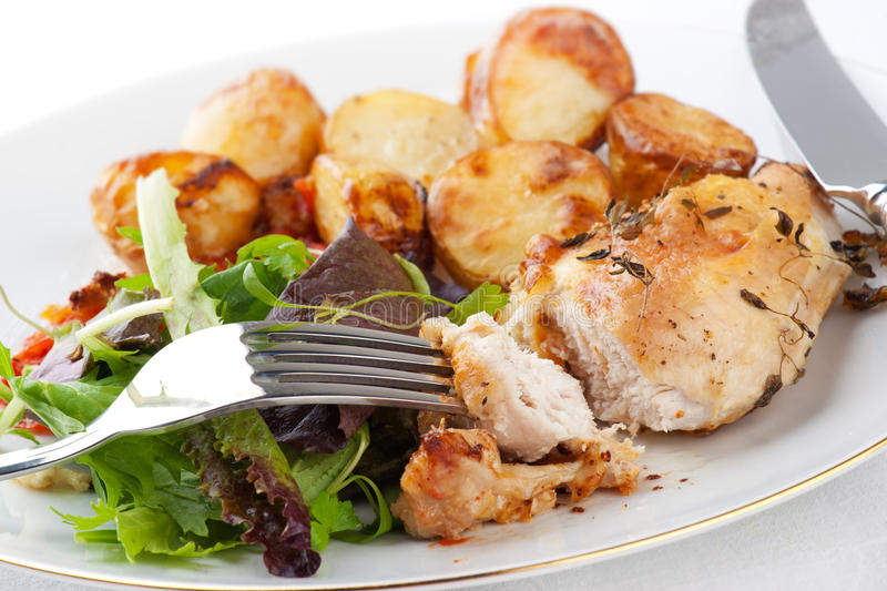 Chicken cooked with rosemary ans vegetables royalty free stock images
