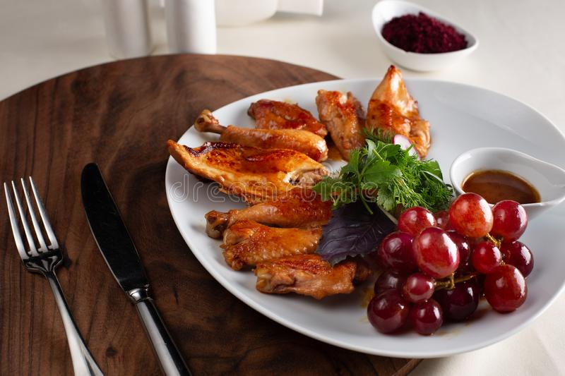 Chicken cooked in wine. On a white plate, served in restaurant royalty free stock images