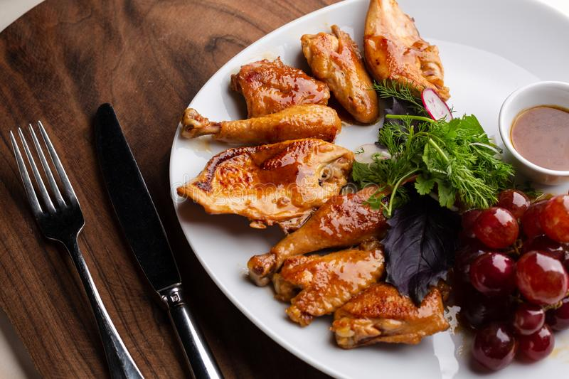 Chicken cooked in wine. On a white plate, served in restaurant stock photo