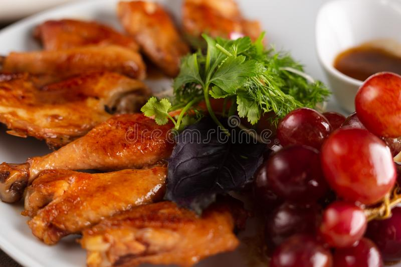 Chicken cooked in wine. On a white plate, served in restaurant royalty free stock photography