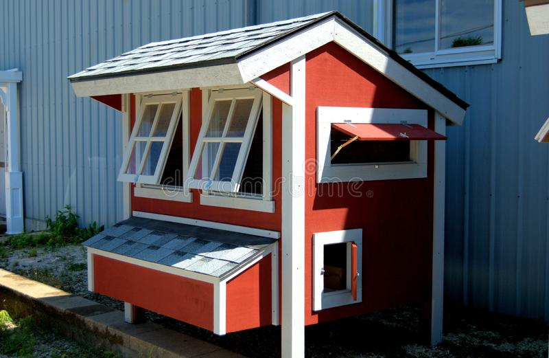 A chicken coop for sale  in the Midwest, U.S.A. A red with white trim chicken coop for sale  in the Midwest, U.S.A royalty free stock images