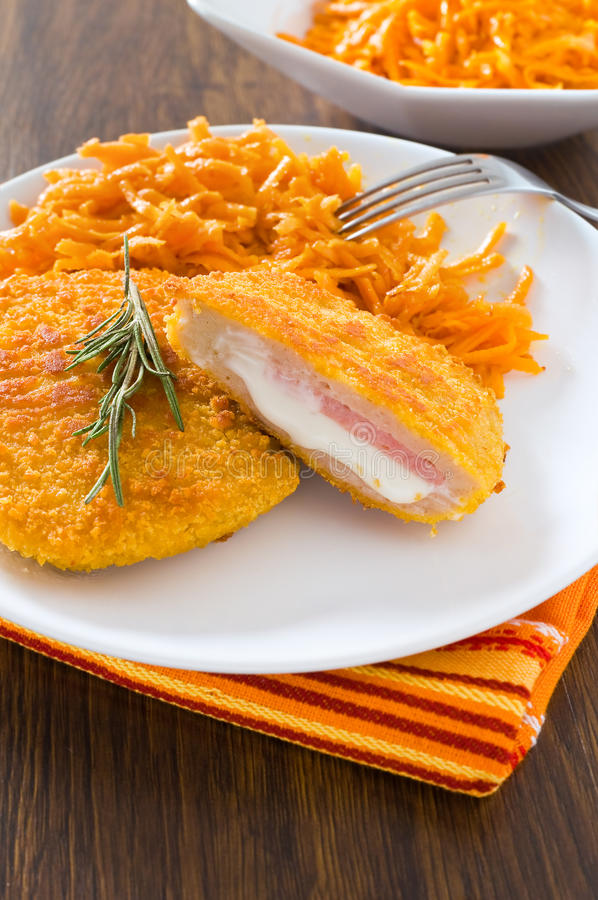 Chicken Cordon Bleu With Grated Carrots. Stock Photo