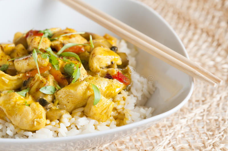 Chicken Curry. In a white bowl with chopsticks royalty free stock photo
