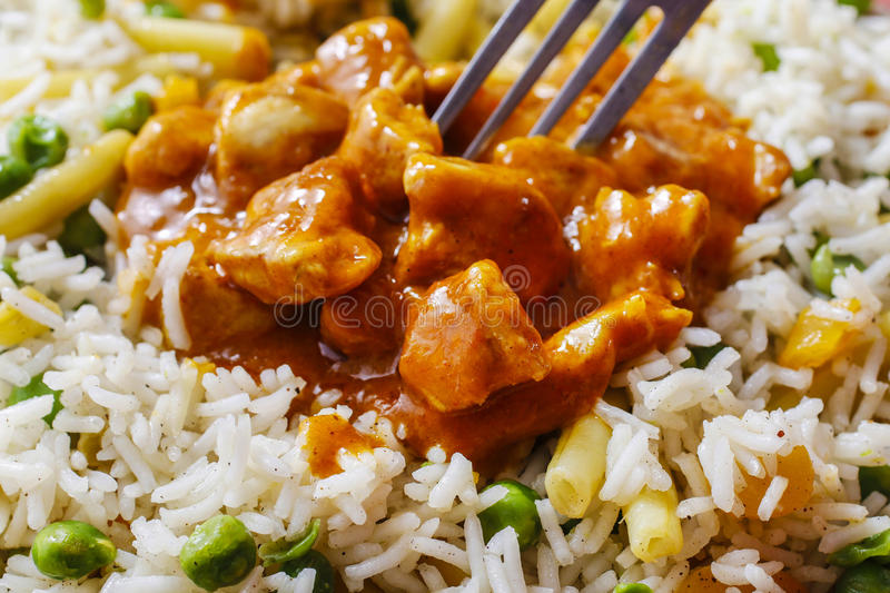Chicken curry with basmati rice and green peas. Dish popular in India royalty free stock photos