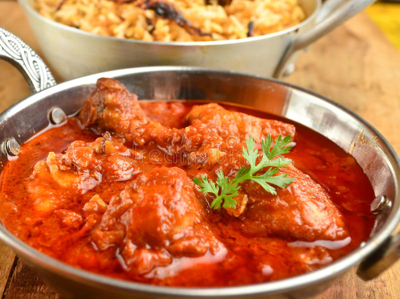 Chicken Curry. Indian Dish of Chicken curry in red curry stock photo