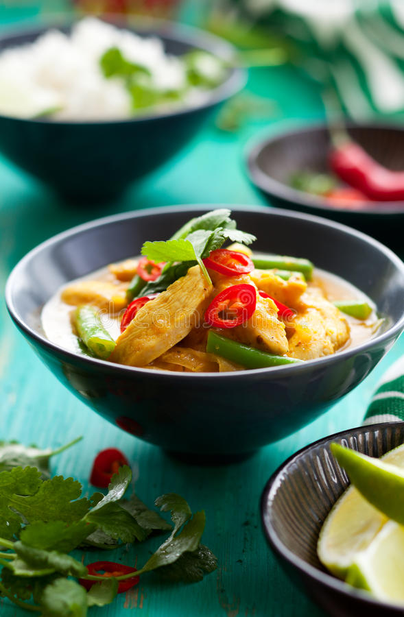 Chicken curry with rice. Chicken curry with green beans and rice stock images