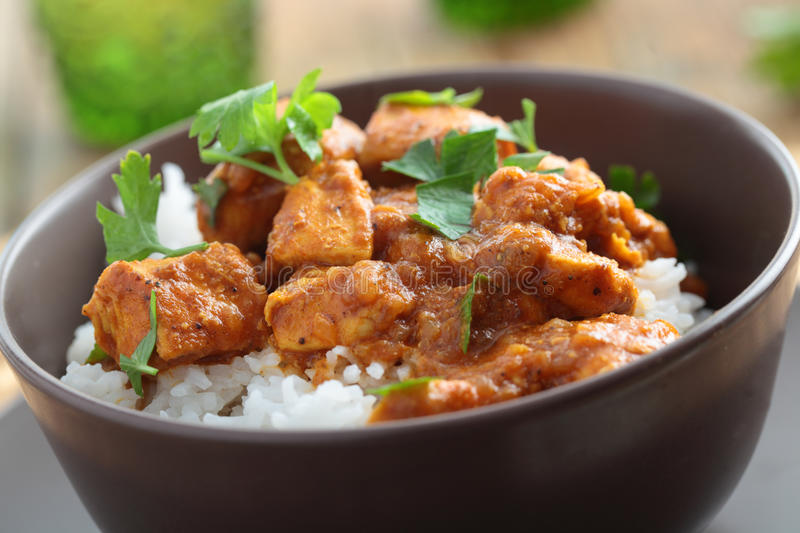 Chicken curry with rice. And parsley in a bowl stock photo