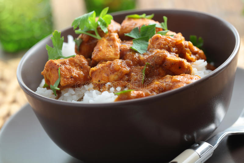 Chicken curry with rice. And parsley in a bowl royalty free stock photos