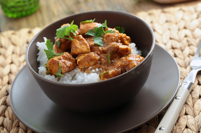 Chicken curry with rice. And parsley in a bowl royalty free stock image