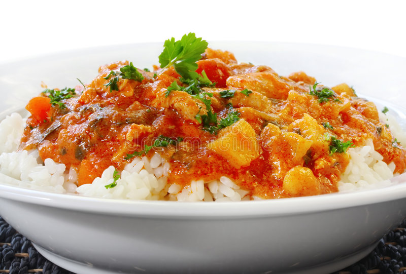 Chicken Curry and Rice. Chicken curry over steamed white rice royalty free stock photography