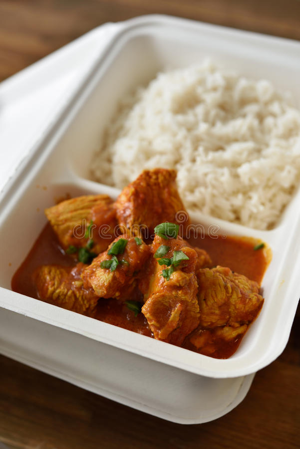 Chicken curry with rice. In a disposable container stock images