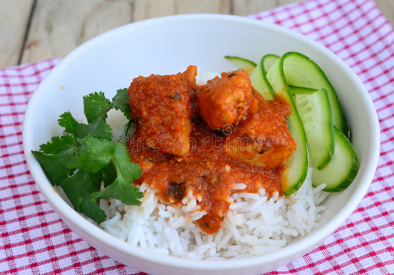 Chicken Curry with rice. Indian Dish of Chicken Curry with salad and rice stock images
