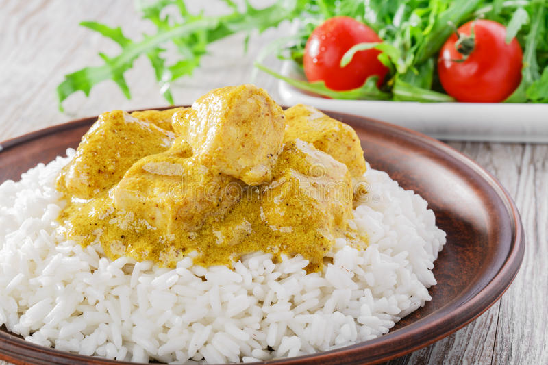 Chicken curry with rice. Salad royalty free stock photography