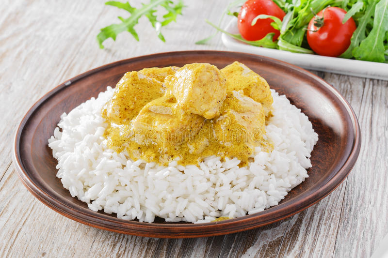 Chicken curry with rice. Salad royalty free stock image