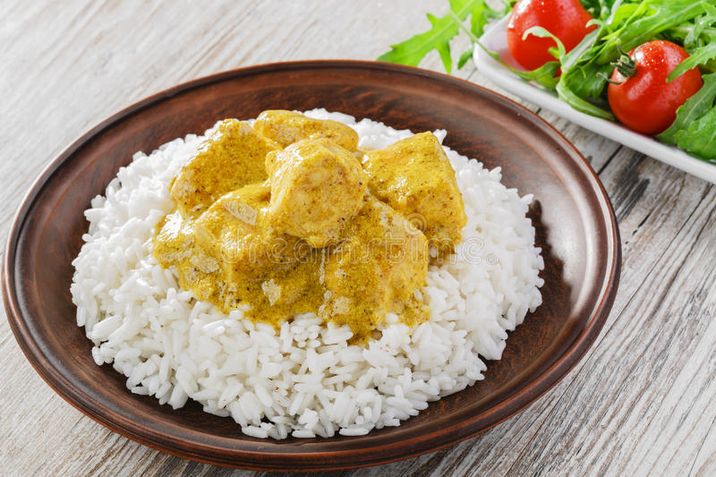 Chicken curry with rice. Salad royalty free stock photo