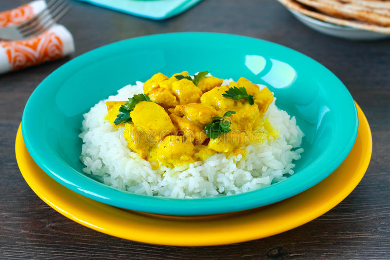 Chicken curry. With rice on wooden table royalty free stock images