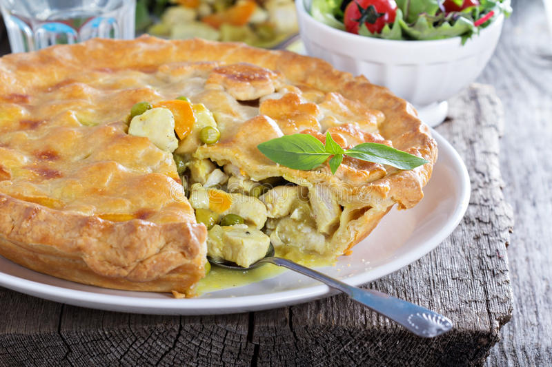 Chicken curry savory pie. With carrot and green peas stock image