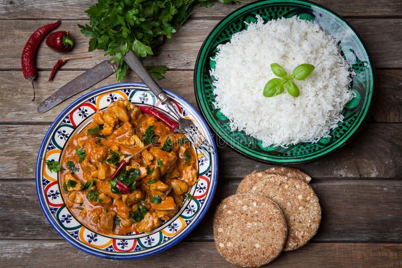 Chicken curry. Tikka masala with basmati rice on decorated bowl royalty free stock images