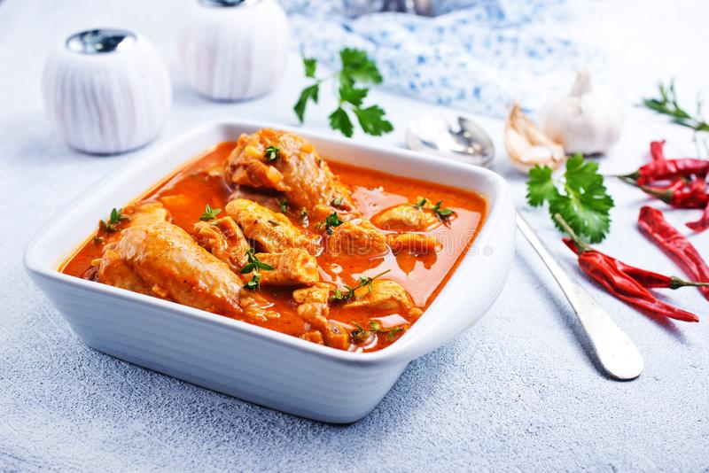 Chicken curry. Traditional Indian dish chicken. Spicy chicken curry in bowl stock image