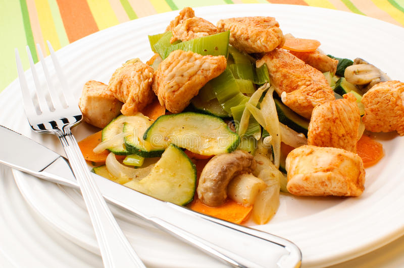 Chicken dinner. Roasted chicken meat with vegetables royalty free stock image
