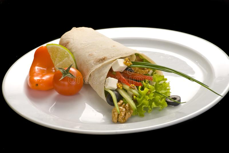 Chicken doner kebab and fresh vegetables in roll of pita bread lavash. Durum Chicken Doner Kebab, dinner, food, green, meal, meat, plate, salad, snack, wrap royalty free stock photography
