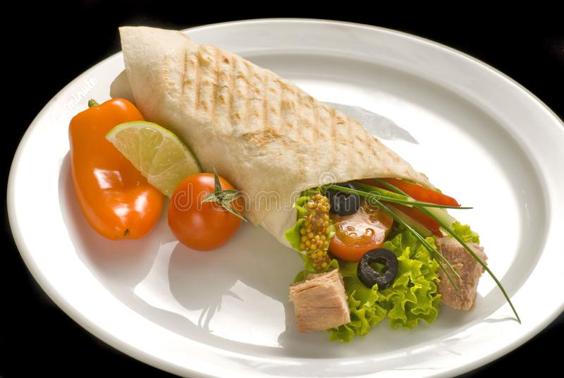 Chicken doner kebab and fresh vegetables in roll of pita bread lavash. Durum Chicken Doner Kebab, dinner, food, green, meal, meat, plate, salad, snack, wrap stock image