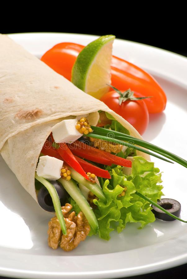 Chicken doner kebab and fresh vegetables in roll of pita bread lavash. Durum Chicken Doner Kebab, dinner, food, green, meal, meat, plate, salad, snack, wrap stock photography