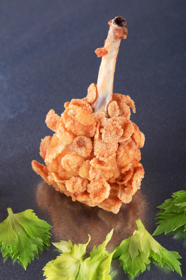 Chicken drumstick coated with corn flakes royalty free stock photo