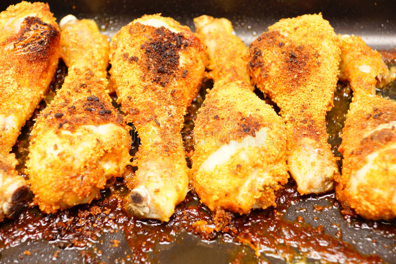 Chicken drumsticks stock images