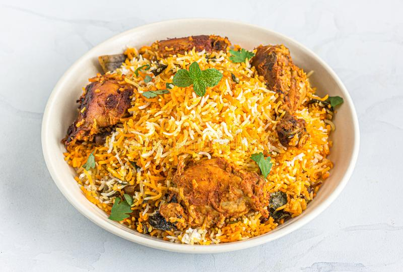 Chicken Dum Biryani in a White Bowl - Traditional Indian One Pot Dish royalty free stock image