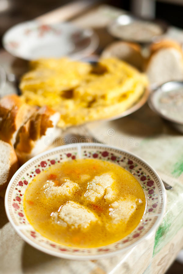Chicken dumplings soup, traditional Romanian food stock images