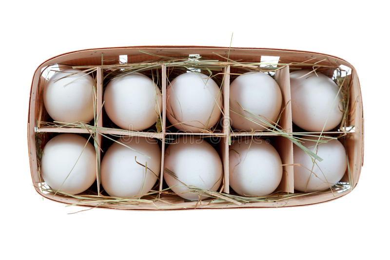Chicken egg in a basket with straw stock images