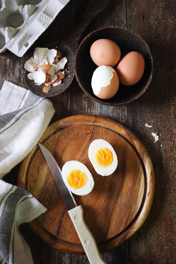 Chicken eggs, boiled and peeled, two halves with yolk stock photo