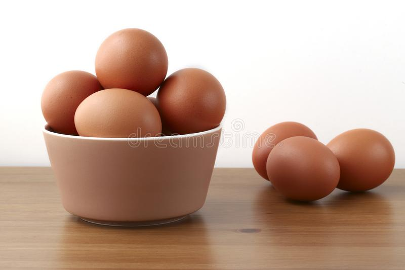 Eggs in a bowl on the table stock image