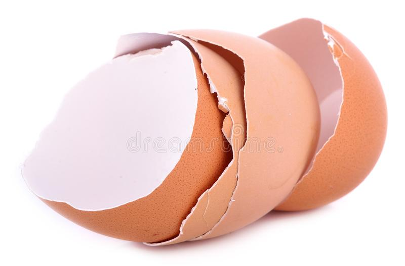 Chicken eggs and egg shell closeup on white background stock photo