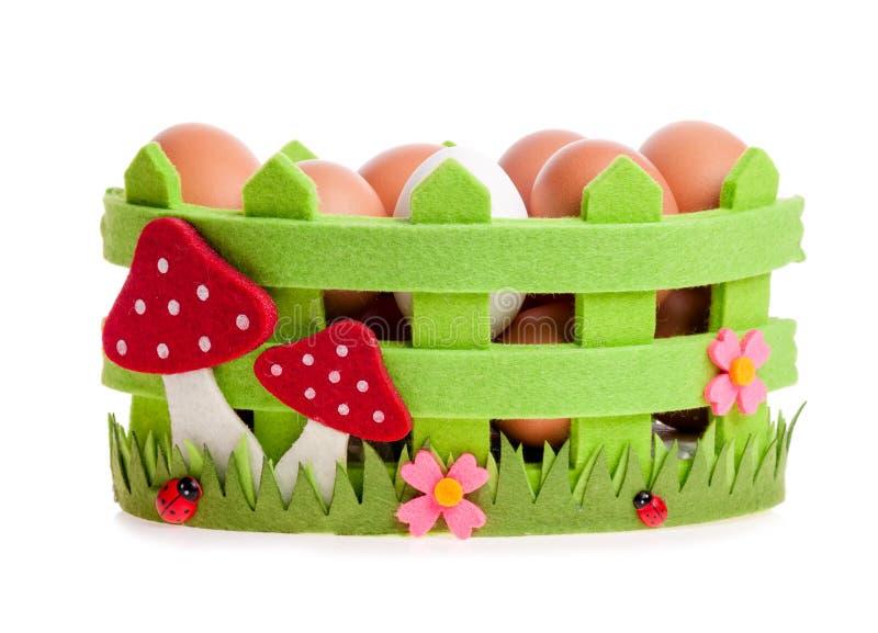 Chicken eggs in the green decorative basket