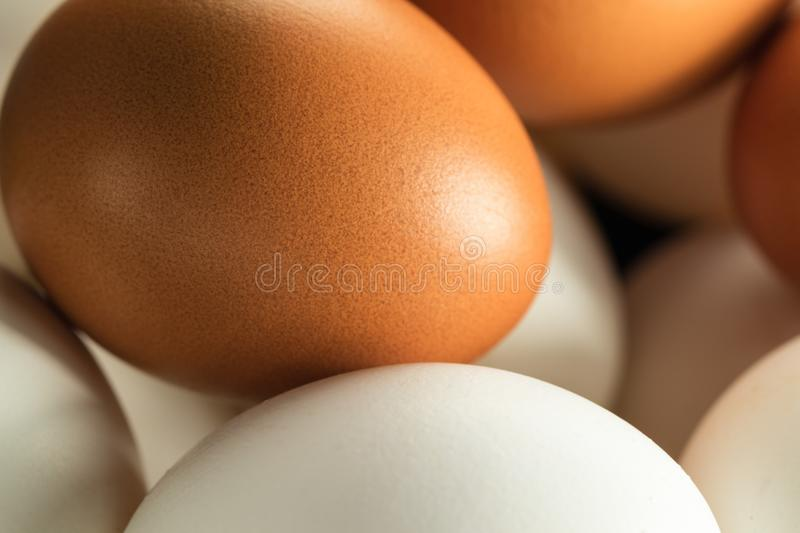 Chicken Eggs Macro. Chicken eggs white and yellow for Easter, macro stock image