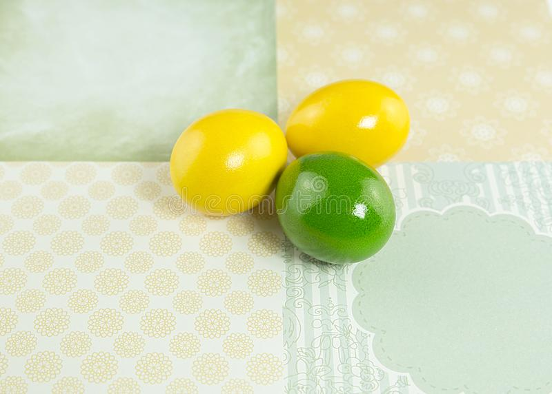 Eggs chicken yellow and green on a decorative background, Easter, object, group of objects, macro, postcard. Chicken eggs mixed colors, yellow and green colors stock photo