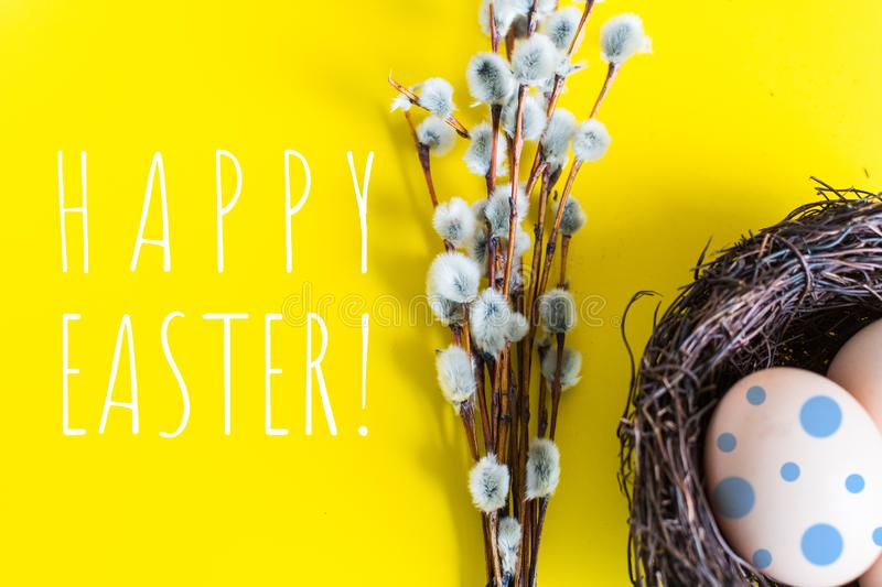 Chicken eggs in a nest with a twig of willow. happy Easter concept stock photo
