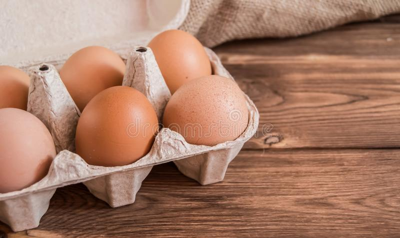 Chicken eggs in the package on the table royalty free stock photography