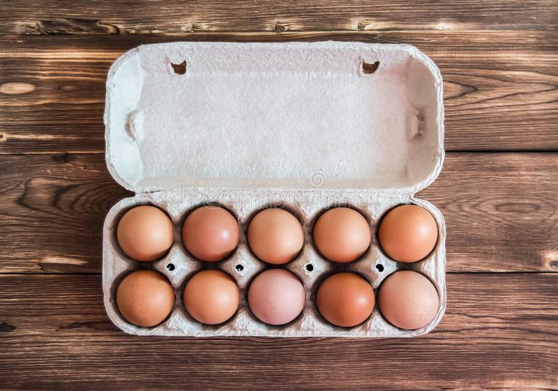 Chicken eggs in the package top view stock photography