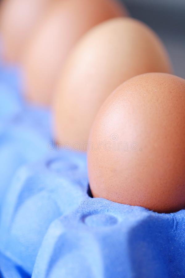 Chicken eggs in the purple package on the table royalty free stock photo