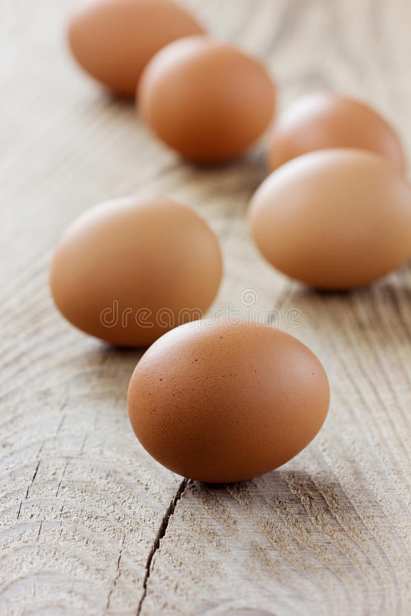 Chicken eggs in rustic style stock image