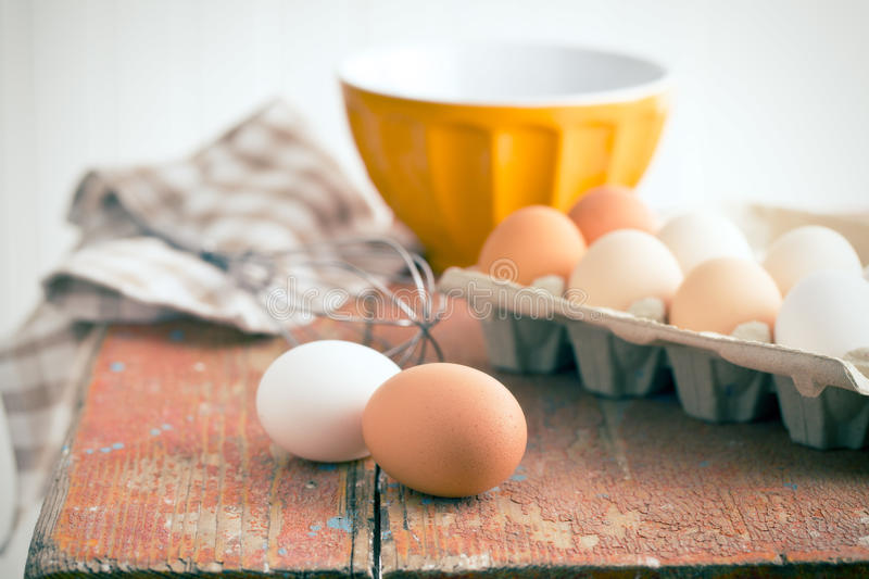 Chicken eggs on table royalty free stock photos