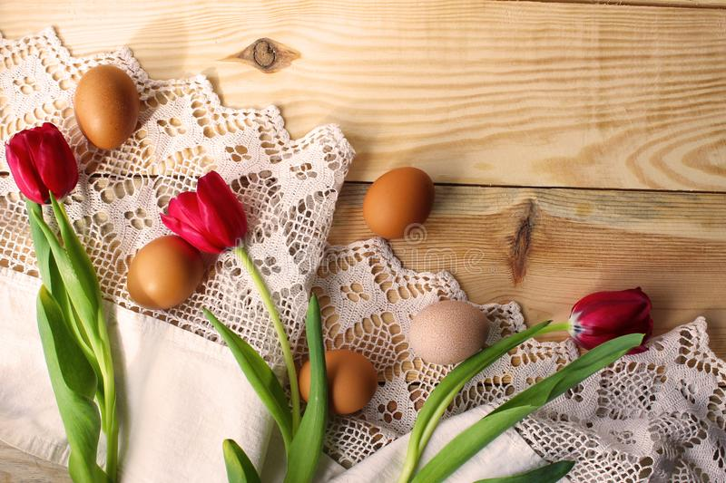 Chicken eggs on a white crocheted tablecloth. Rustic style. The concept of Easter, rustic life, spring. Healthy food, egg diet, homemade food royalty free stock image