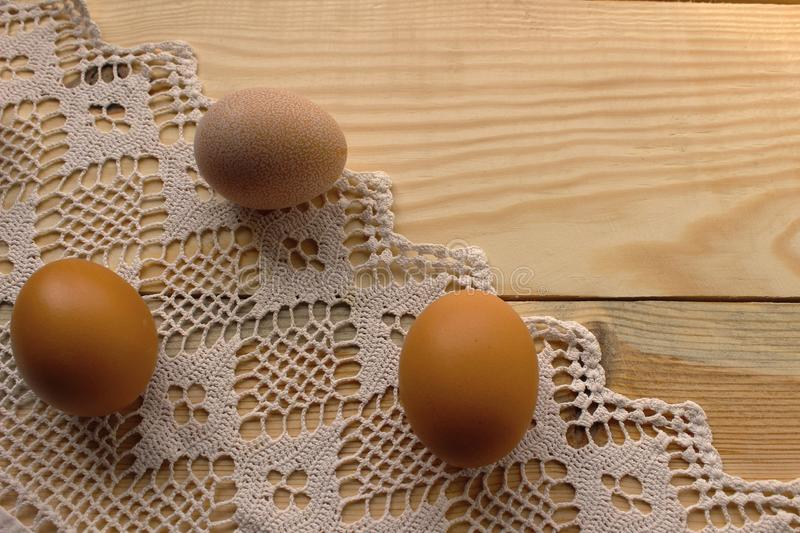 Chicken eggs on a white crocheted tablecloth. Rustic style. The concept of Easter, rustic life, spring. Healthy food, egg diet, homemade food royalty free stock photos