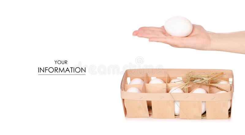 Chicken eggs in a wooden box of hay in hand pattern stock photography
